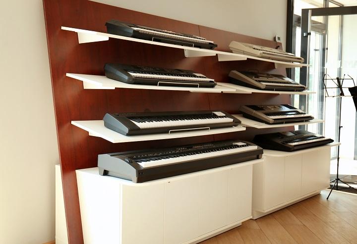Digital pianos on shelves