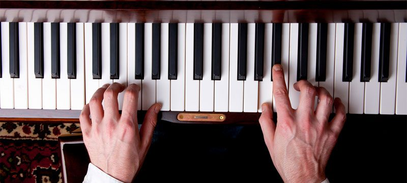 Why are your fingers numbered when learning the piano, and how does it work?