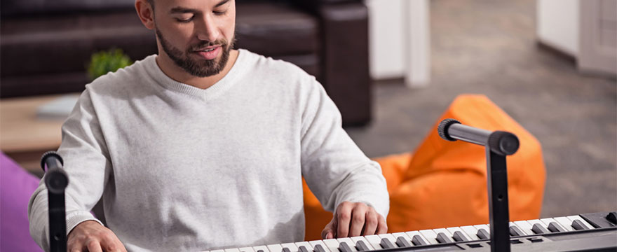 What is muscle memory and how can it help when learning to play the piano?